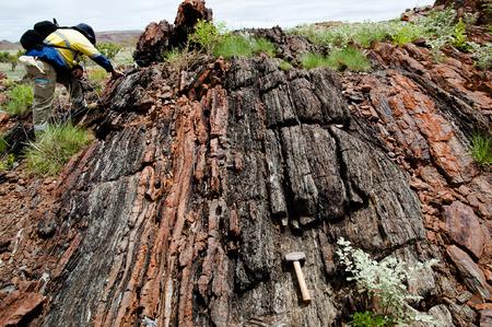 Geologist Examining a Banded Iron Formation- Pilbara - Australia Foto de archivo