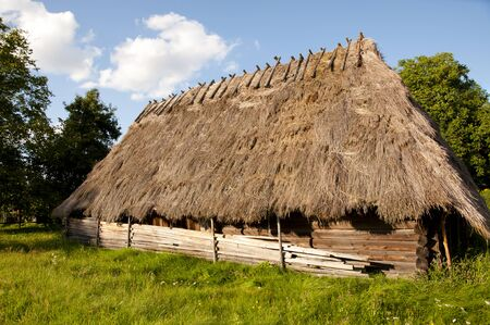 a house with a straw: Old Wooden Straw House - Poland