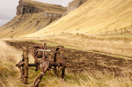 machinery: Rusty Agricultural Machinery - Iceland Stock Photo