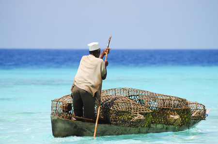 merchant: Merchant Transporting Goods - Zanzibar - Tanzania Stock Photo