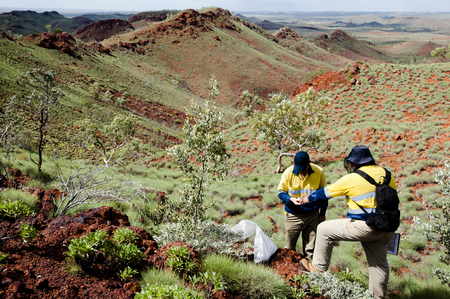 geologists: Exploration Geologists Sampling Archean Rocks - Pilbara - Australia Stock Photo
