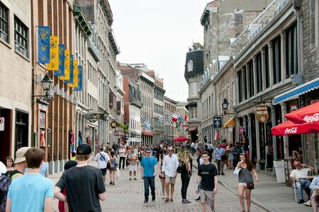 old port: MONTREAL, CANADA - May 29, 2015: Popular St Paul street in the Old Port one week before the F1 Grand Prix