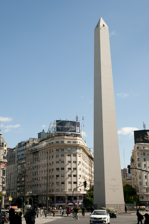 BUENOS AIRES, ARGENTINA - April 6, 2009:  The Obelisk seen in traffic on 9 de Julio Avenue