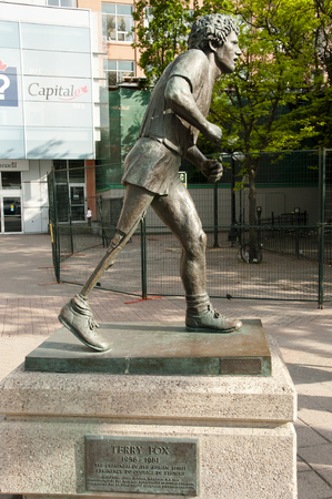 resulted: OTTAWA, CANADA - May 26, 2015: Statue of Terry Fox who ran across Canada in an effort to raise money for cancer. This resulted in an annual Terry Fox run marathon to raise money for that cause.