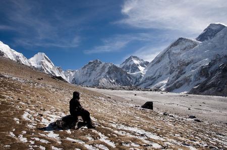 sherpa: Sherpa Resting at Pumori Peak - Nepal Stock Photo