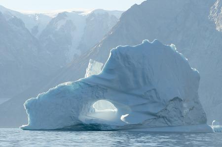 sund: Pierced Iceberg- Scoresby Sound - Greenland Stock Photo