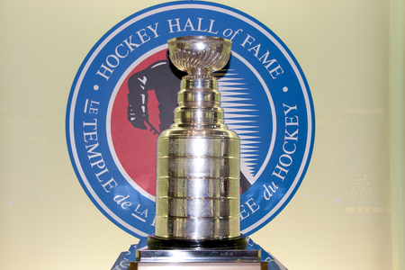 each year: TORONTO, CANADA - March 9, 2016: Stanley Cup on display in the hockey hall of fame. The trophy is given to the NHL champion each year.