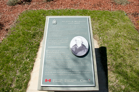 cemetary: KINGSTON, CANADA - April 21, 2016: First prime minister Sir John A. Macdonald grave plaque in historic Cataraqui cemetary