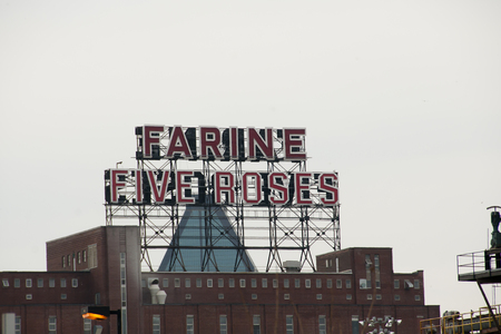 industrial park: MONTREAL, CANADA - May 29, 2015: Farine Five Roses is a brand of flour and its sign is a popular symbol for the city of Montreal Editorial
