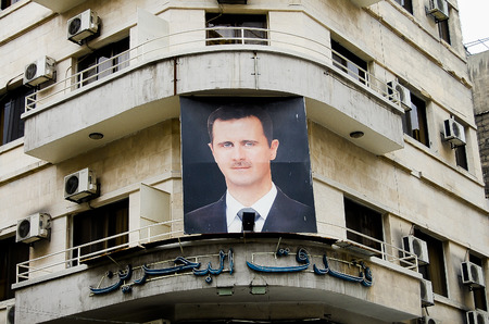 DAMASCUS, SYRIA - JANUARY 14, 2010:  Photo of president Bashar al-Assad on a building in the capital city before the outbreak of the civil war Editorial