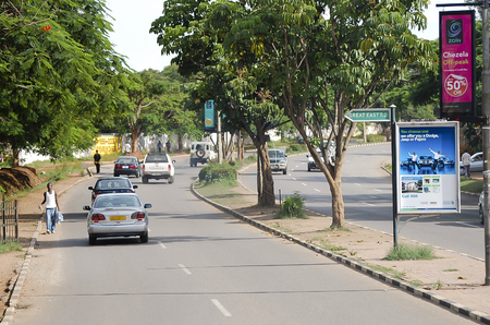 autos: LUSAKA, ZAMBIA - DECEMBER 15, 2008: Daily traffic on the main boulevard in the capital city