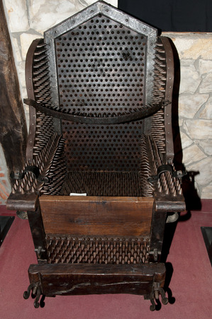 anguish: Judas Chair Torture Device Stock Photo