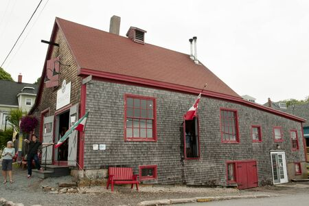 ironworks: LUNENBURG, CANADA - August 14, 2016: Ironworks distillery is a micro-distillery located in the old port of Lunenburg on Nova Scotias historic UNESCO South Shore