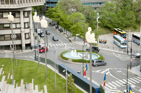 ANDORRA LA VELLA, ANDORRA - May 22, 2016: The Seven Poetas by Jaume Plensa are located in front of the Consell General dAndorra and overlooking the streets