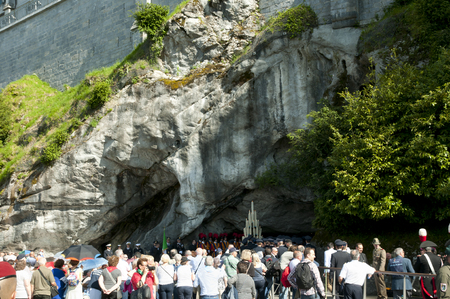LOURDES, FRANCE - May 21, 2016: Religious mass held near the Cave of Apparitions in the Lourdes Sanctuary