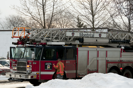 MONTREAL, CANADA - January 7, 2016: Fire truck arrives near school in an emergency call