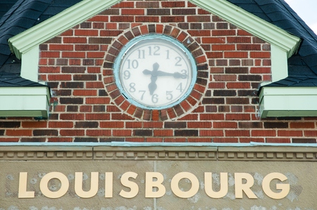 scotia: Brick Wall Clock - Louisbourg - Canada