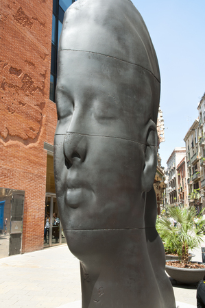 BARCELONA, SPAIN - May 24, 2016: Statue of Carmela by sculptor and engraver Jaume Plensa is a figure that seems to change depending on the perspective and the location of the observer