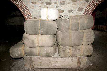 Old Stuffed Burlap Bags in Cellar