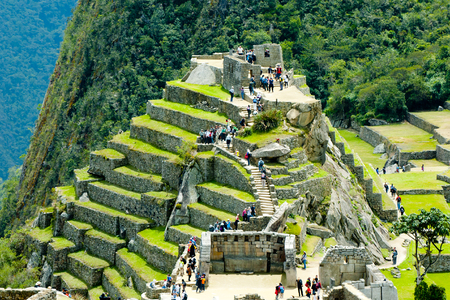 Tourist visiting Machu Picchu Steep Terraces - Peru