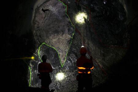 Underground Geologist in Mining Tunnel