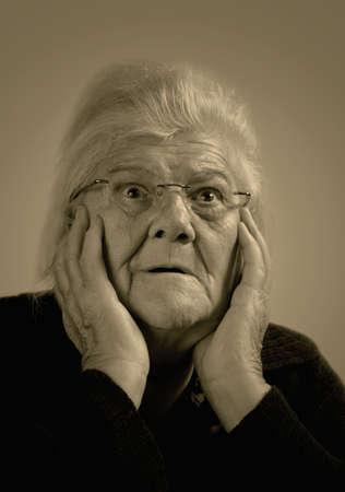 Scared elderly woman.