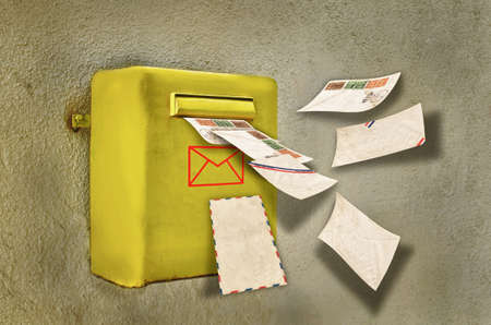 postes: Letters flying into a old mailbox Stock Photo