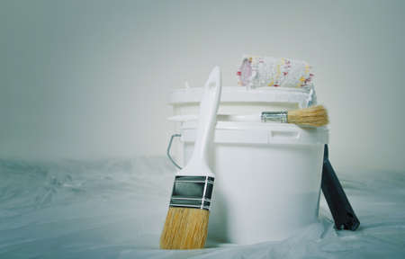 painting and decorating: Bucket and brush ready for painting. Decorating concept