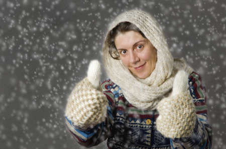 wintertime: Portrait of smiling woman in the snow. Weather concept. Stock Photo