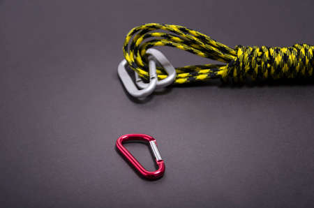 Mountaineers carabiner with climbers rope
