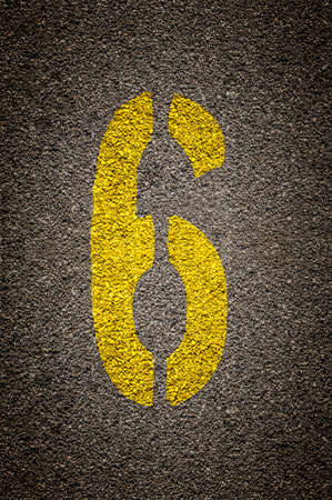 Stencil numbers print on asphalt background - check my portfolio for other numbers Foto de archivo