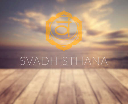 Svadhisthana chakra symbol. Poster for yoga class with a sea view.