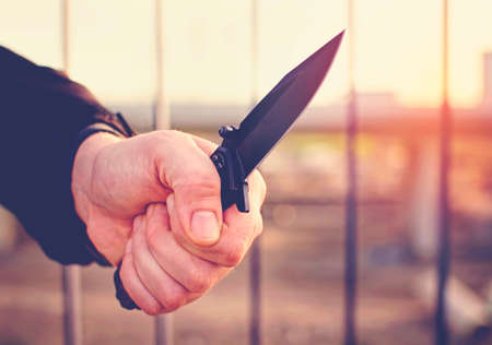 acute: Hand with knife. Street violence concept. Stock Photo