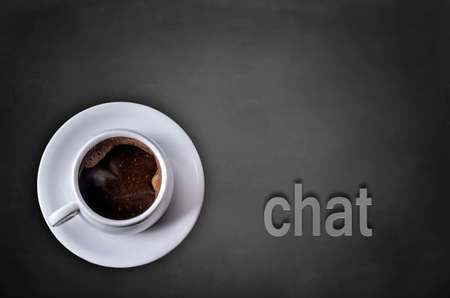Chat word on blackboard with coffee cup