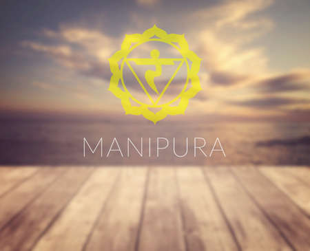 manipura: Manipura chakra symbol. Poster for yoga class with a sea view. Stock Photo