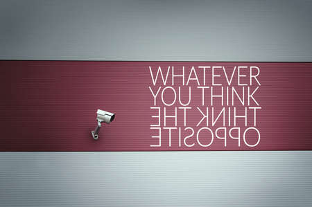 Whatever you think Think the opposite text on wall