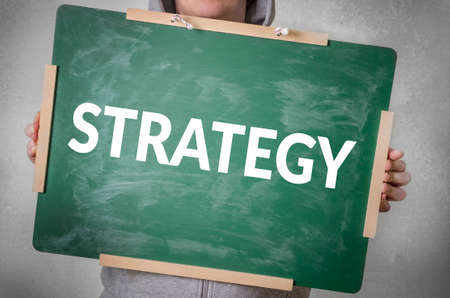 marketingplan: Strategy text written on chalkboard