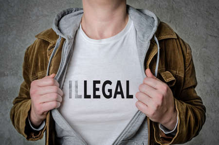 Man showing Legal tittle on t-shirt. Choosing Legal instead of Illegal. Stock Photo