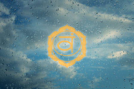 Svadhisthana chakra symbol. Poster for yoga class with a clouds view.