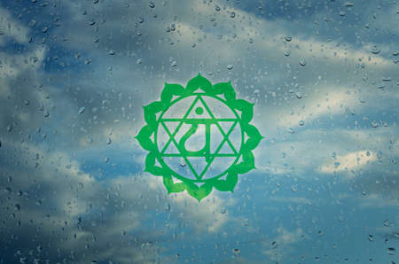 sahasrara: Anahata chakra symbol. Poster for yoga class with a clouds view. Stock Photo