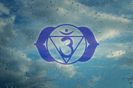sahasrara: Ajna chakra symbol. Poster for yoga class with a clouds view. Stock Photo