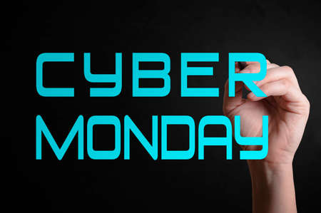 christmas savings: Hand writing Cyber Monday with marker on transparent wipe board.