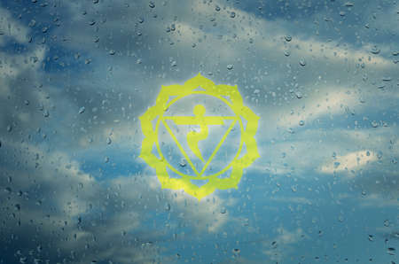Manipura chakra symbol. Poster for yoga class with a cluds view.