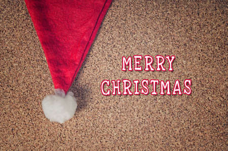 paper pin: Christmas red hat with Merry Christmas text Stock Photo