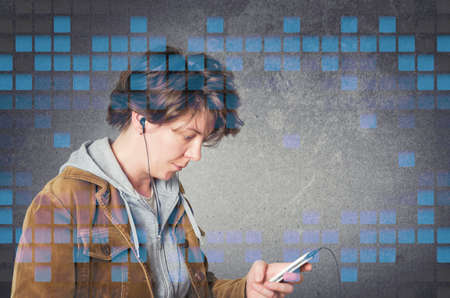 ear buds: Woman using earphones from smart phone, listening to music. Stock Photo