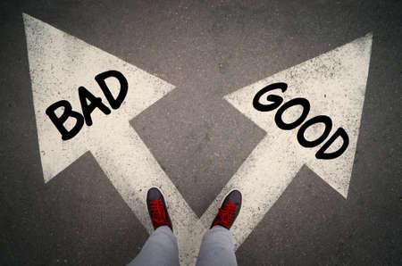 GOOD versus BAD written on the white arrows, dilemmas concept.