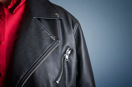 Detail of a black leather biker jacket. Cropped closeup shot of a man wearing leather jacket.
