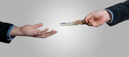 Businessman`s hand holding Euro currency, offers 50 euro bank note money. Giving money, paying by cash, business, banking, loan concept.