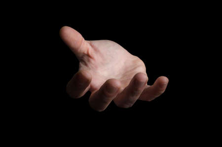 Open male hand isolated on black background. Selective focus on fingers. Help, need, charity concept. Reklamní fotografie