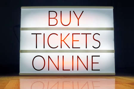 Buy tickets online lightbox Stock Photo